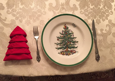 learn how to fold a napkin into the shape of a christmas tree click here to watch the tutorial