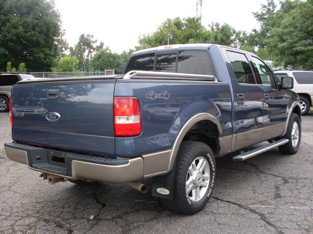 Ford F Blue on 2004 Gmc Envoy Black