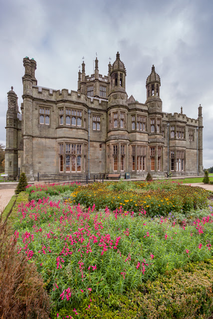 Flowers bloom in front of Margam Castle in South Wales by Martyn Ferry Photography