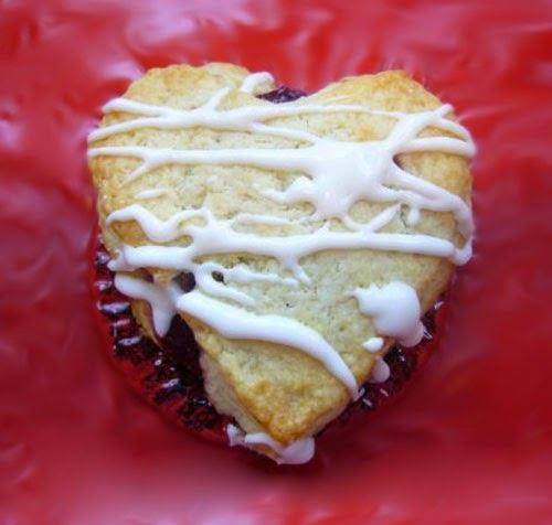 Raspberry Scones with Rosewater Glaze: Valentine's dat treat of heart-shaped scones stuffed with raspberry jam and served topped with a rosewater glaze.