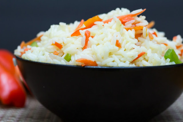 A colorful variation to plain white rice dressed up with carrots, sweet peppers and onions #HomeMadeZagat