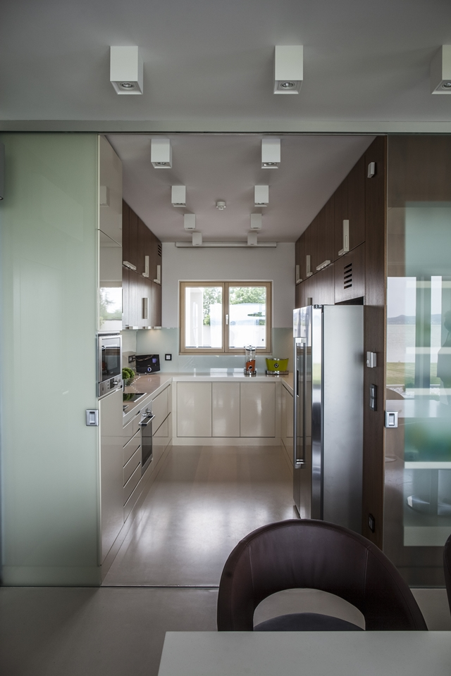 Small modern kitchen in the Lake Side Duplex House