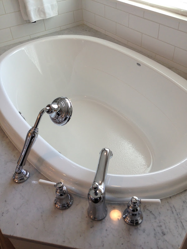 Maax Slimline Oval with Kohler Bancroft fixtures title=