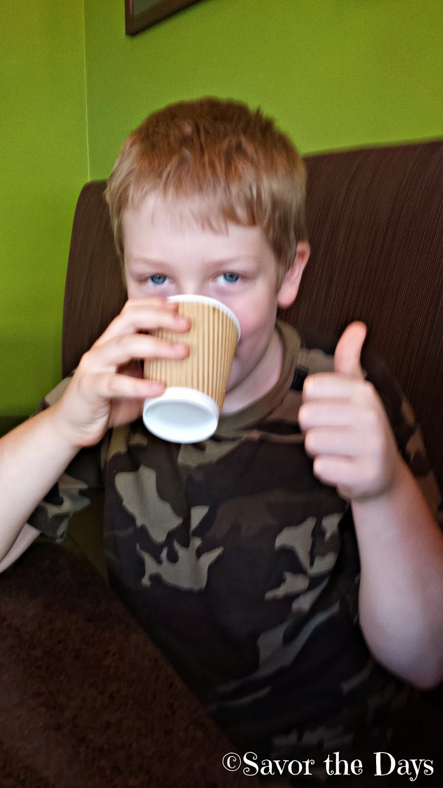 boy drinking hot chocolate