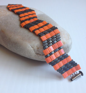 https://www.etsy.com/listing/237756019/orange-and-grey-beaded-bracelet-coral