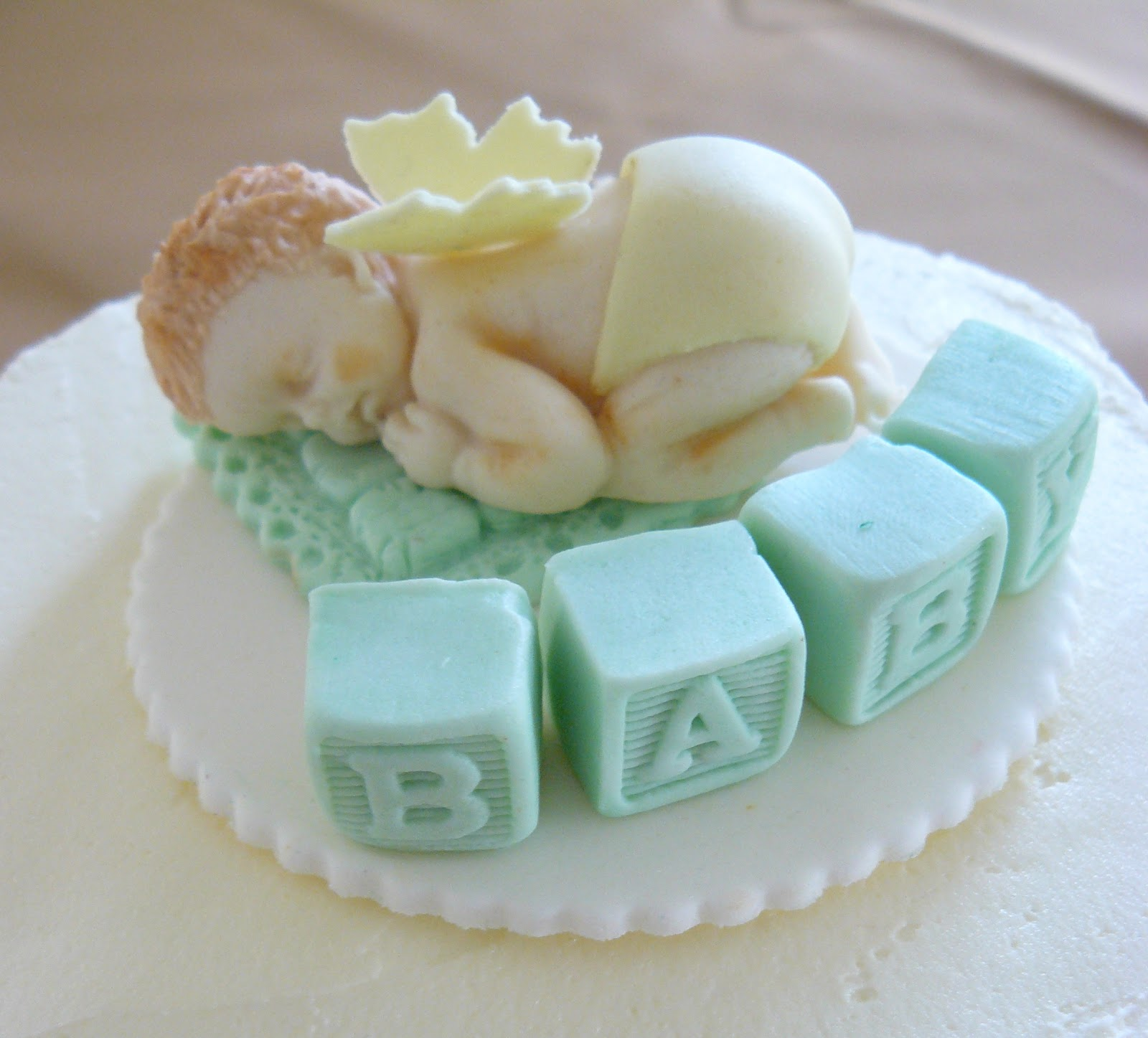 Cute Baby Shower cake topper. This baby is sitting perfectly on top of ...