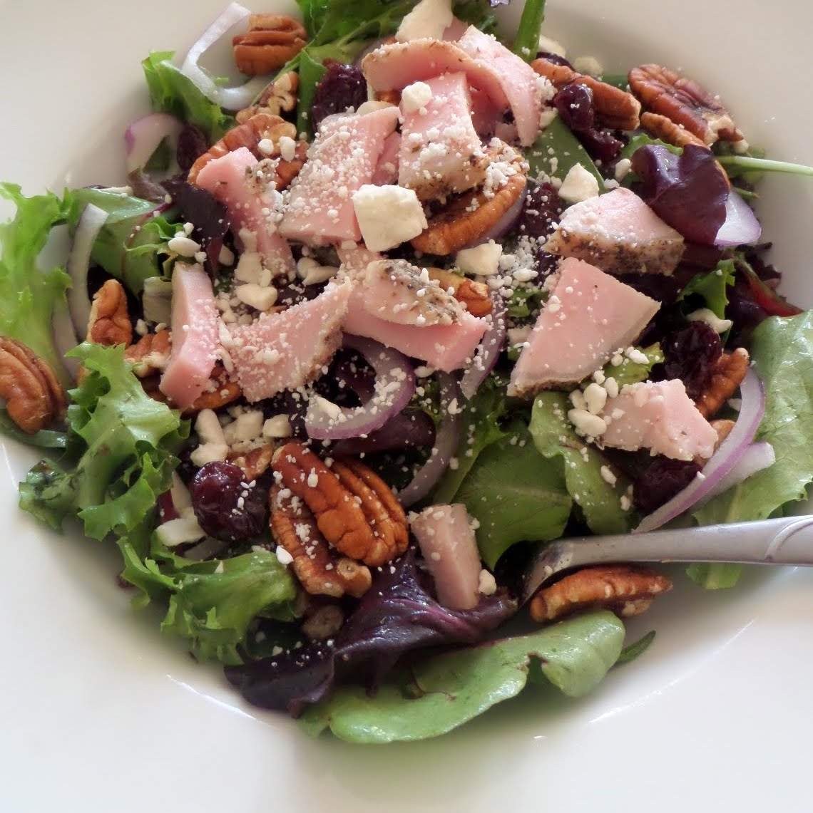 Pork Tenderloin Salad:  Tender Herb Roasted Pork Tenderloin on a green salad tossed in a lemon thyme dressing.
