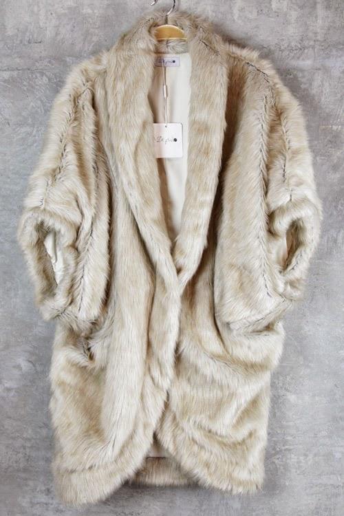 http://www.swankboutiqueonline.com/oversized-fur-shrug/