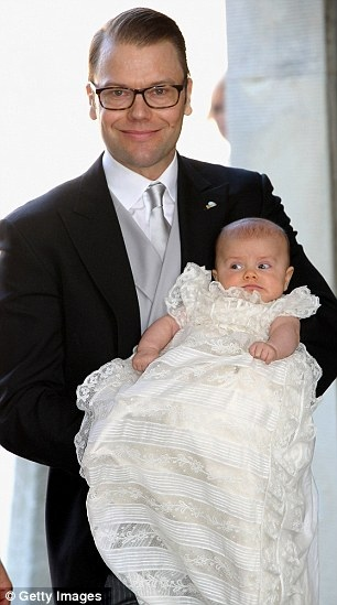 Proud parents: Crown Princess Victoria, who married her former gym trainer Daniel in a ceremony in 2010, hold Princess Estelle, wearing a gown that has been used for Swedish royal christenings since 1907