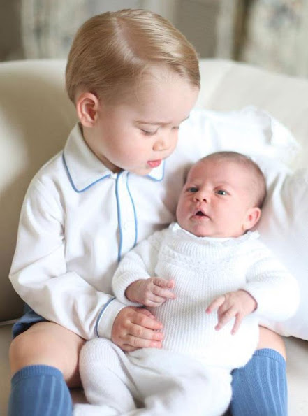 Kensington Palace on Saturday released the first official portrait of Prince George and his new sister Princess Charlotte. It was taken by Kate Middleton in mid-May.