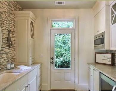 Fotos de cocinas dise ar una cocina for Cocinas con salida al patio