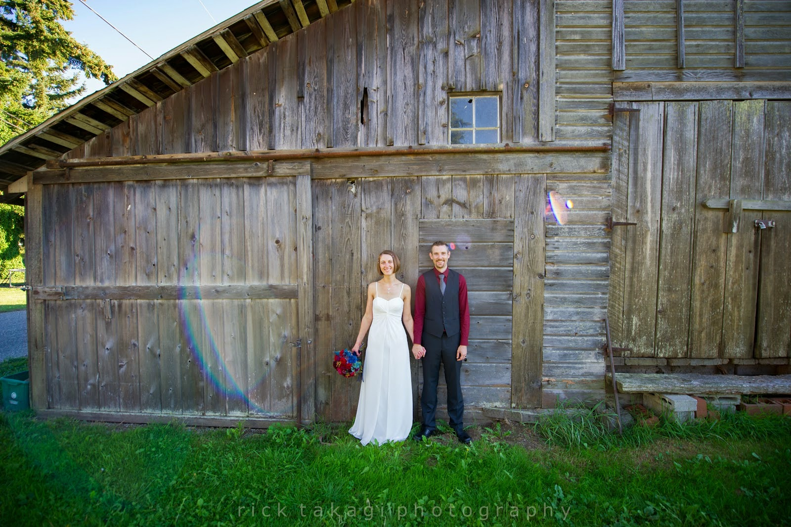 Aaron & Ashley pose in from of the barn at The Grand Willow Inn - Patricia Stimac, Seattle Wedding Officiant