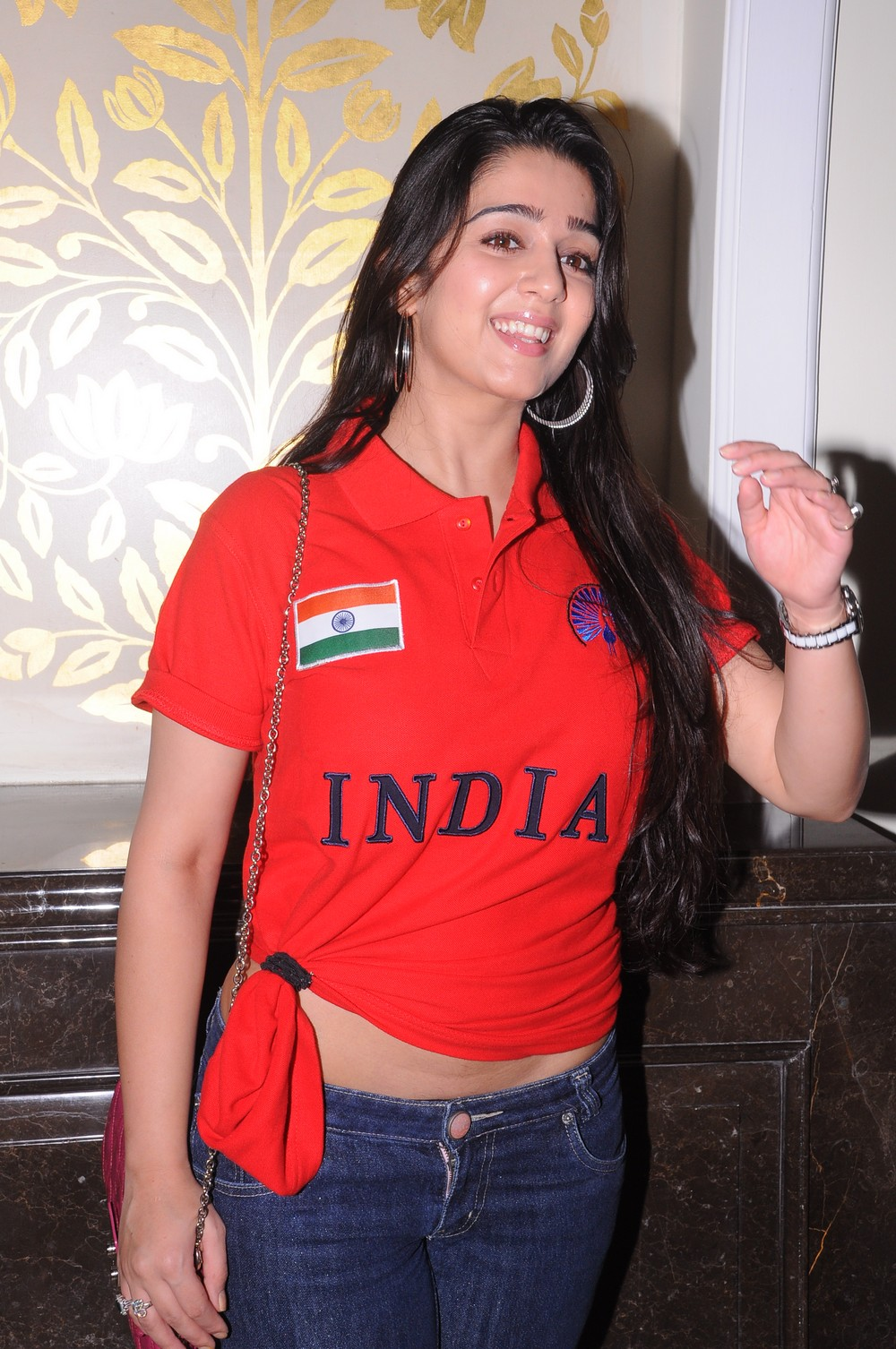 hot indian girl Charmi stills in red t shirt at brand launch