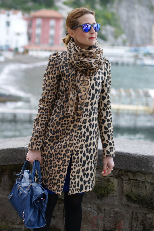 leopard print coat, Balenciaga city bag, Oakley mirrored sunglasses