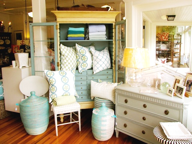 COCOCOZY pillows in light blue and sage as part of a display