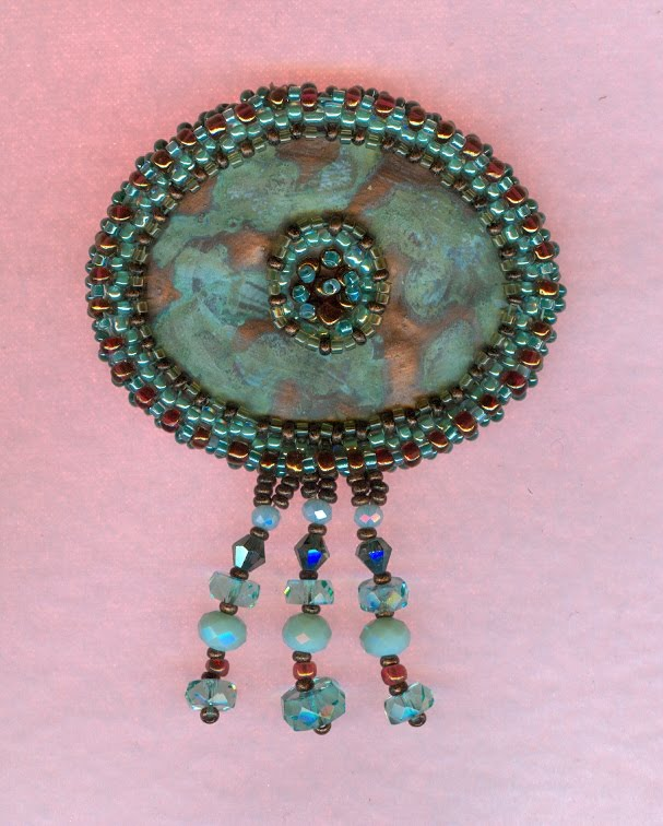 Pin copper patina and beads