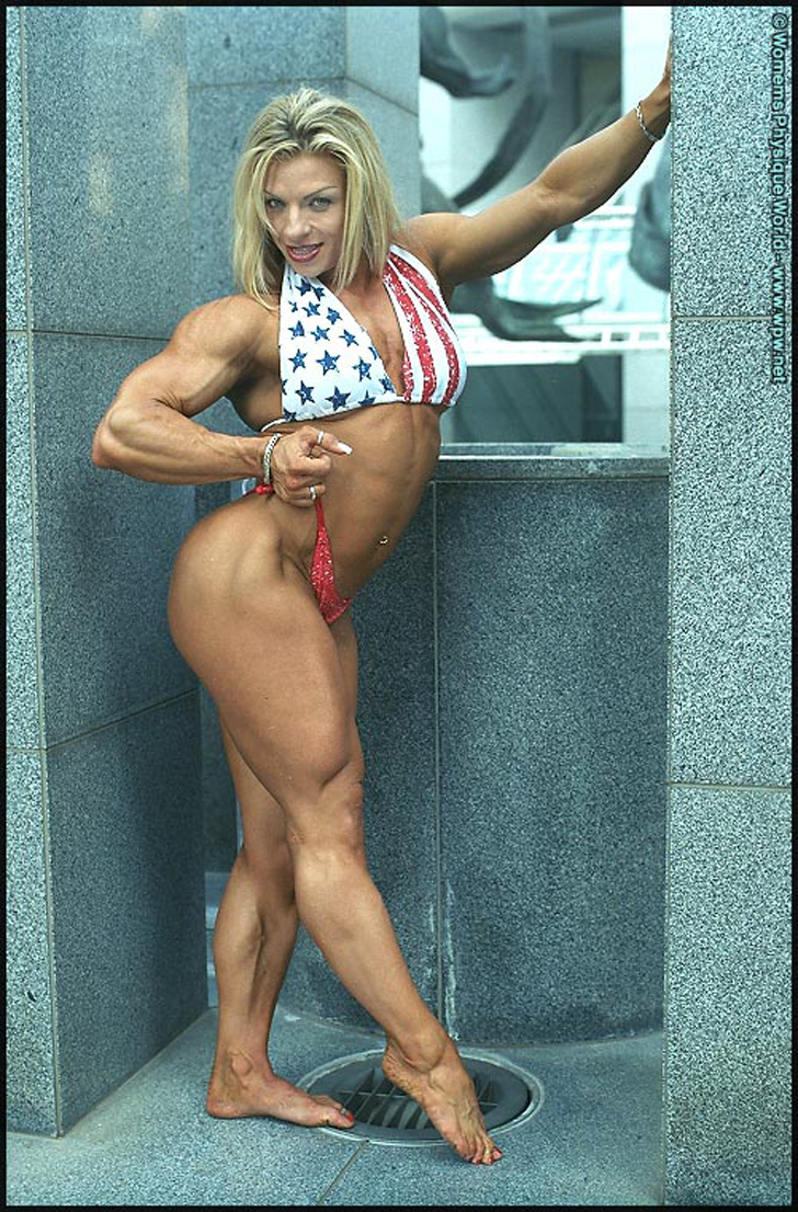 Debi Laszewski Modeling Her Muscular Legs And Biceps In A Bikini