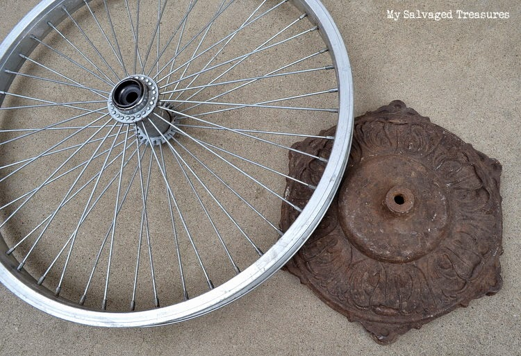 repurposed bicycle wheel and lamp base DIY picture holder