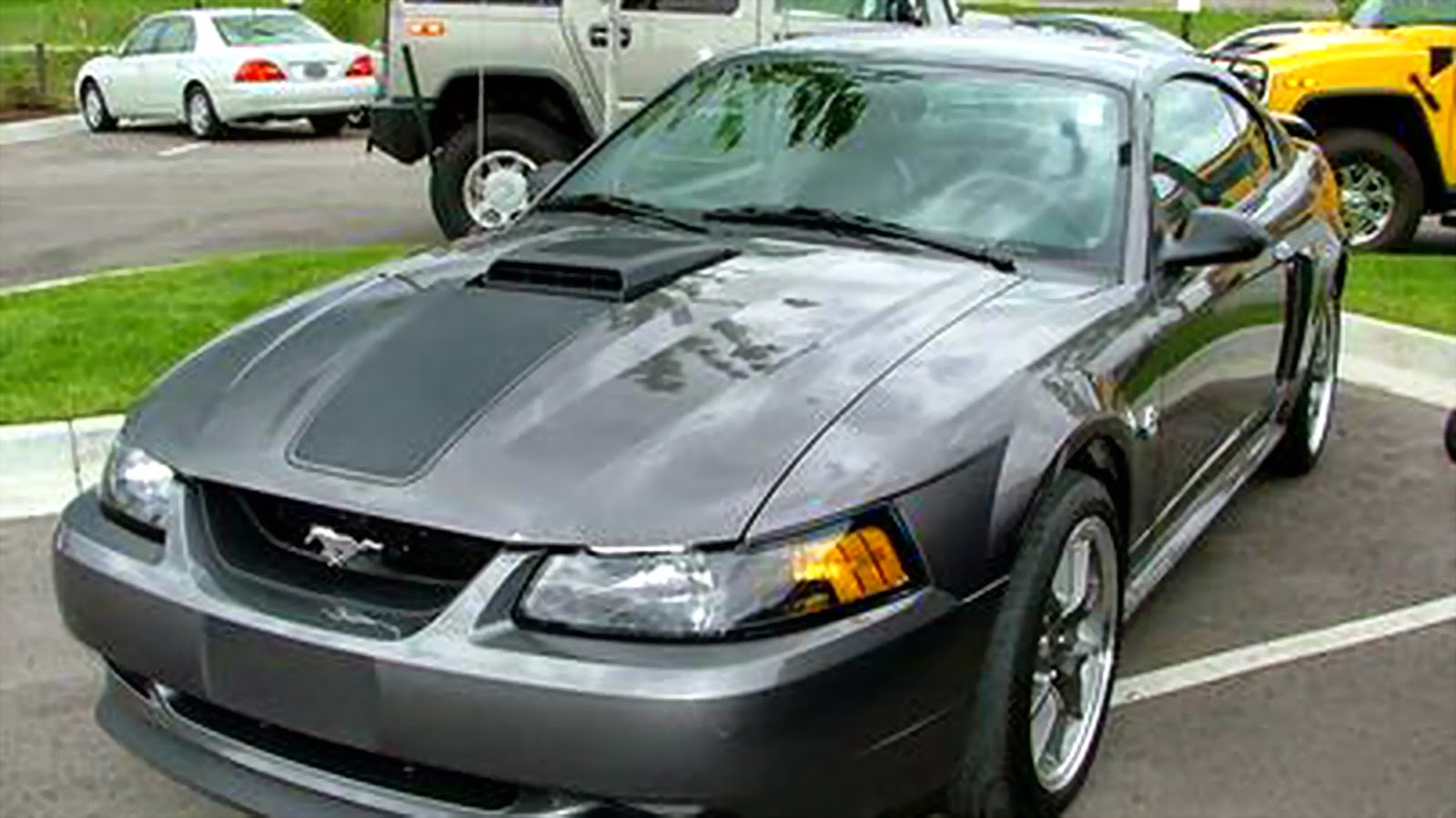 Mustang coupes get 50 50 split folding rear seatbacks standard equipment on all mustangs includes air conditioning power windows and locks