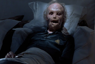 Gary Oldman as the horifically disfigured Mason Verger, only surviving victim of Dr. Lecter, Hannibal, Directed by Ridley Scott