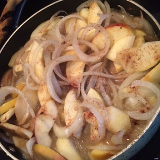 Pork chops, apples and onion simmering