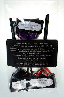 Gourmet hard-candy Love Triangle lollipops in packaging - back view