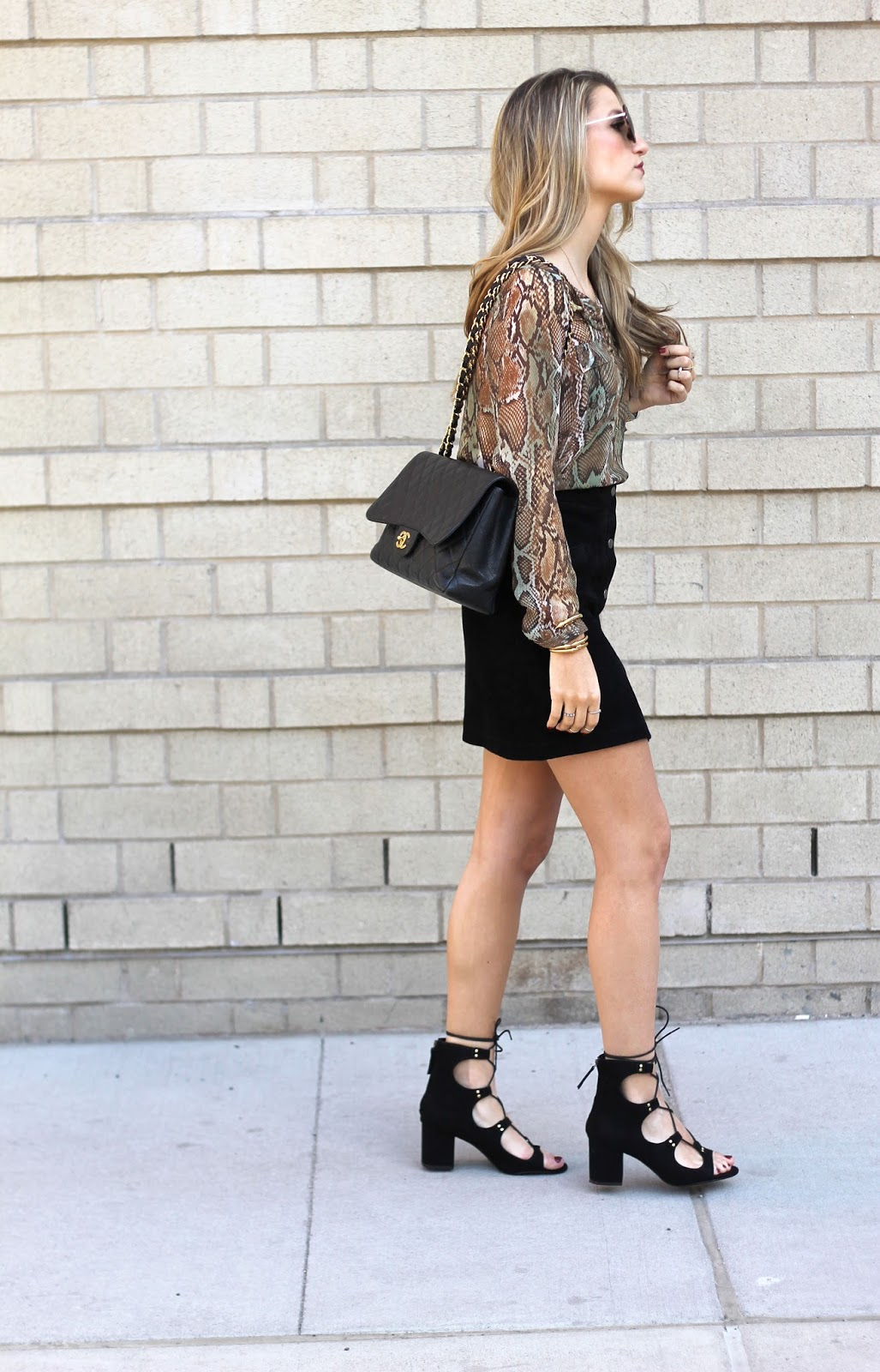 snake print blouse, black lace up heels