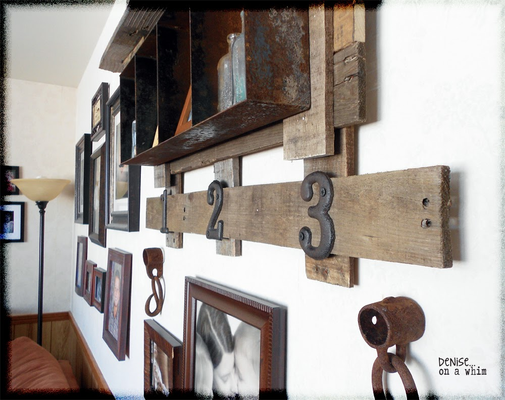 A rust and pallet wood combo make for a warm addition to this gallery wall via http://deniseonawhim.blogspot.com