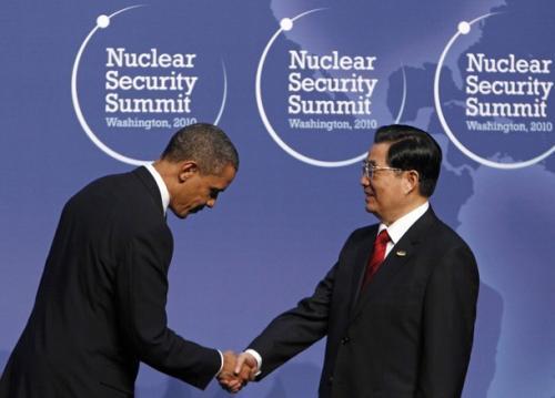 U.S. President Barack Obama bows before Chinese Premier Hu Jintao