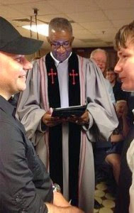 Rev. Wendell Griffen of New Millennium Baptist Church, performing one of many same-sex marriages in Little Rock 12 May 2014
