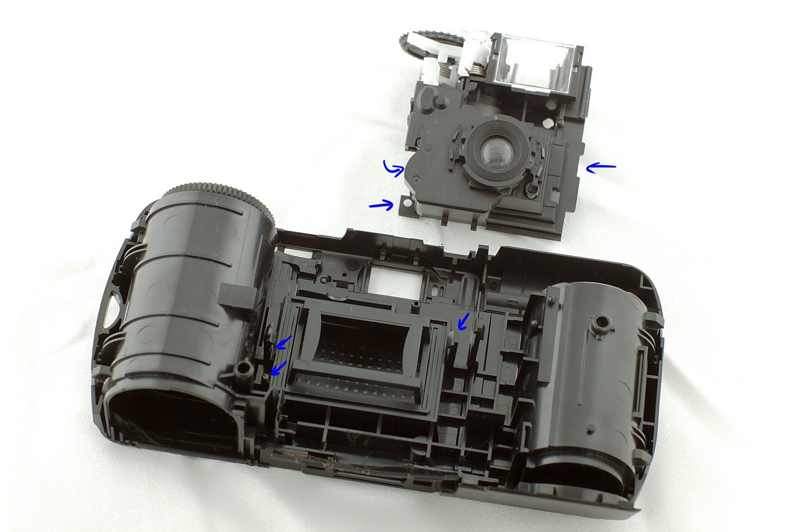 Highly Entropic Taking Apart A Disposable Camera Circuit Kodak Flash Schematic The Lens Unit Can Be Taken Further Exposing And Shutter Leaf Its Just Small Obvious Plastic Clip I Dont Show How To Do This