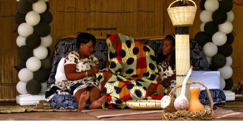 Kitchen parties a truly zambian tradition embarking to africa the bride to be sits under a chitanga waiting for the groom to be to arrive junglespirit Choice Image