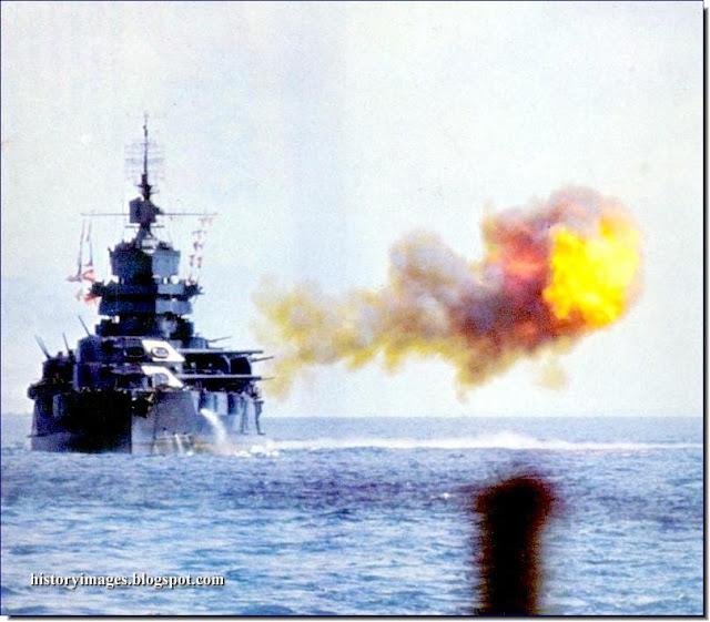 American battleship USS Idaho fires  Japanese fortifications Okinawa