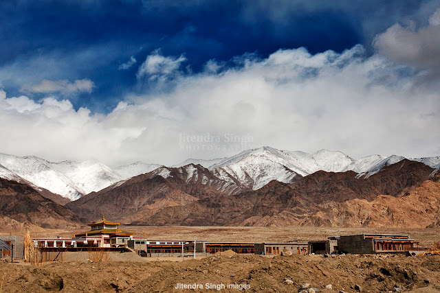 After a Great PHOTO JOURNEY from Barsana Holi, now Jitendra is taking us to Leh through his phenomenal Photographs.  All these photographs were shot at Leh in the month of Feb last year (Feb, 2012). Let's check out this Photo Journey and enjoy wonderful landscapes, people and culture of Leh.Leh was the capital of the Himalayan kingdom of Ladakh, now the Leh District in the state of Jammu and Kashmir, India. Leh is the second largest district in the country (after Kutch, Gujarat) in terms of area.Over the time, Leh has become one of the hot destination for Tourists and Photographers. We always see wonderful photographs from Leh and all these motivate almost everyone to visit Leh, click these wonderful landscapes and come back with great memories to cherish for. At Photo Journey, we planned many Leh trips and there are some great plans in 2013 as well. Some of the passionate Photographers have come together to plan a great trip to Leh through Spiti Valley and some of the passionate Bloggers & Travellers are also joining. Above photograph shows a wonderful frame from a market - vehicles moving around and people walking on the footpath. For most of the folks, it's hard to imagine a vacation at Leh during winters. But trends are changing and now people love exploring Leh during winters as well. Above photograph shows one of the views from Leh - snow covered courtyard. Ladakh is a region of India in the state of Jammu and Kashmir which lies between the Kunlun mountain range in the north and the main Great Himalayas to the south , inhabited by people of Indo-Aryan and Tibetan descent. It is one of the most sparsely populated regions in Jammu and Kashmir.Leh also presents great opportunities to explore different cultures, colors and various unique things all around.It includes the Baltistan (Baltiyul) valleys, the Indus Valley, the remote Zangskar, Lahaul and Spiti to the south, Aksai Chin and Ngari, including the Rudok region and Guge, in the east, and the Nubra valleys to the north.Since Ladakh is a part of strategically important Jammu and Kashmir, the Indian military maintains a strong presence in the region. The largest town in Ladakh is Leh. It is one of the few remaining abodes of Buddhism in South Asia, including the Chittagong Hill Tracts, Bhutan and Sri Lanka... a majority of Ladakhis are Tibetan Buddhists and the rest are mostly Shia Muslims. Some Ladakhi activists have in recent times called for Ladakh to be constituted as a union territory because of its religious and cultural differences with predominantly Muslim KashmirThe economy of Ladakh rests on three pillars: the Indian Army, tourism, and civilian government in the form of jobs and extensive subsidies. Agriculture, the mainstay only one generation ago, is no longer a major portion of the economy, although most families still own and work their land. In past, Ladakh enjoyed a stable and self-reliant agricultural economy based on growing barley, wheat and peas and keeping livestock, especially yaks, cows, dzos  sheep and goats. Animals are scarce and water is in short supply. The Ladakhis developed a small-scale farming system adapted to this unique environment. The land is irrigated by a system of channels which funnel water from the ice and snow of the mountains. The principal crops are barley and wheat. Rice was previously a luxury in the Ladakhi diet, but, subsidised by the government, has now become a cheap staple.In the past, Ladakh gained importance from its strategic location at the crossroads of important trade routes, but since the Chinese authorities closed the borders with Tibet and Central Asia in the 1960s, international trade has dwindled except for tourism.