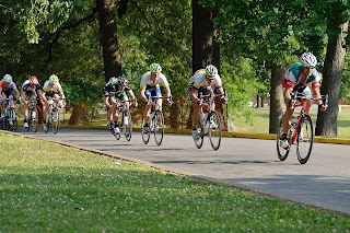 picture of bicycle racers at the River City Bicycle Classic riding through sunshine