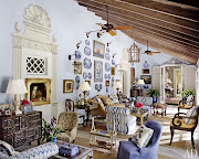 . a Portuguese chestonstand is positioned beneath an antique English . (boca grande florida beach house)