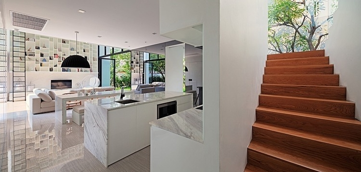 White kitchen and stairs in Modern mansion in Singapore