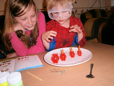 children having fun with science kit