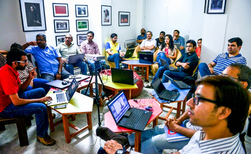 After a long time, I planned to do another workshop on Adobe Photoshop Lightroom with Delhi Photography Club in Shahpur Jat, Delhi. Founder of DPC, Mr Virendra Singh Shekhawat connected with me & encouraged me to plan one in Delhi again. I couldn't plan it in Jan, because of various commitments in office and at home. Finally we did one this weekend. Delhi Photography Club has this brilliant office in Shahpur Jat and place is created very thoughtfully by Virendra and Team. Taking a Lightroom workshop at such place was definitely a very good break from routine life and all these workshops offer to lot of learnings. Yes, you read it right - I learn a lot while teaching Adobe Photoshop Lightroom to like minded Photographers. I really enjoy these workshops and during this 2 days workshop, I didn't even take any break. I realized it laters :). And I would want to add that participants of this workshop were awesome. Some of the folks were already using Adobe Photoshop Lightroom for editing their photographers and few of them had used Photoshop. But majority of them were not using any software to organize or edit the photographs. Apart from Photoshop, Picasa is one of the most popular software amongst the participants and I wonder why? Picasa is definitely not for this set of photographers. It was quite an interactive workshop wherein participants asked lot of questions and I could address most of them. Although there were few questions which were not answered completely at the end, due to lack of time. During 2 days, we majorly talked about Library and Develop modules - essentially the ways of managing photographs and different editing controls. Folks from different walks of life joined this workshop. For most of them Photography is not a medium of earning their bread and butter, but it's a serious hobby. There were few, who are doing photography professionally. Most of the folks were carrying their laptops and hence, there were lot of questions after trying things we discussed in the workshop. Some of the questions were relevant to all while few of them were not. Most of these were taken up  between the session and few of them were addressed separately with individuals. This group was pretty fast in picking up things and hence we could cover a bit more than usually we do in this 2 days workshop. During this workshop, we talked about Catalogs, Collections, import, managing metadata, watermarking, smart collections, keyword tags, search capabilities on the basis of inbuilt/IPTC metadata, presets for metadata & editing, snapshots, history, smart previews, editing controls like - Exposure, Contrast, Highlight, Shadows, white, blacks, clarity, vibrance, saturation, HSL, Black & White processing, Lens correction, handling luminance and color noise, reducing chromatic aberration, vignetting, Spot healing, cropping, straightening, graduated filter and lot more.Things like importance of Raw files and Histogram was also discussed. Basics of color profiles & file formats to be used in Export were also discussed. Backing up images and Lightroom catalogs was one of the important aspects.  There were few discussions about importance of single vs multiple catalogs. The ways to import from one catalog to another was a primary question when everyone realized that single catalog is brilliant way to manage all the photographs. Although some of them wanted to try different catalogs for different genres of photography.Check out the vibrant walls of Delhi Photography Club. I am in love with this place after this workshop and hope to visit them frequently during weekends and probably their Photo-walks as well.A day very well spent with Indian Lightroomers !