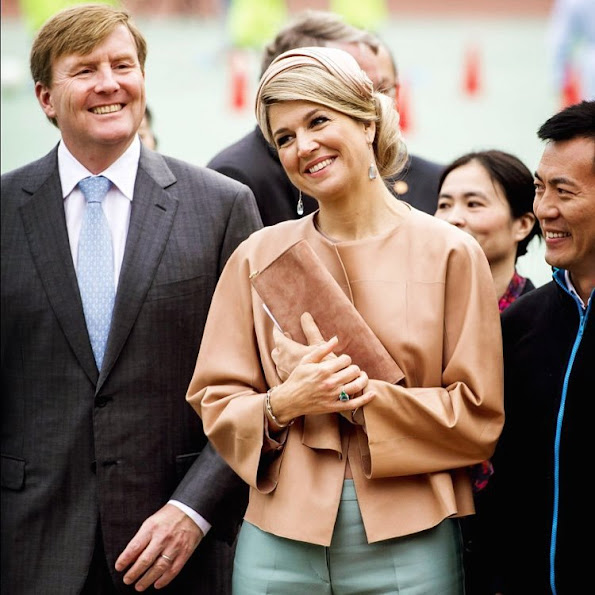 Queen Maxima and King Willem-Alexander of The Netherlands visit the Sino-Dutch Diary Development Center on October 25, 2015 in Beijing, China