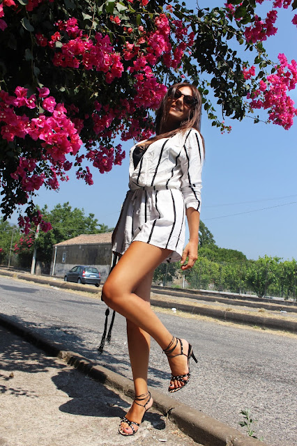 http://www.oasap.com/jumpsuits-playsuits/56343-vertical-striped-print-surplice-romper.html/?fuid=235465