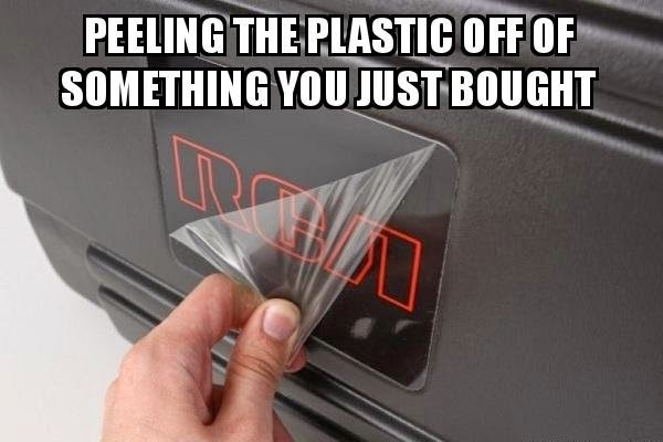 peeling the plastic off from new purchased items