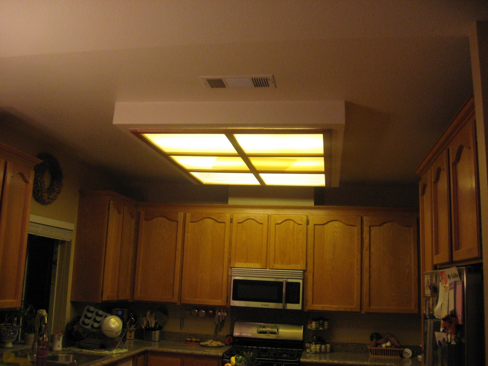 To replace a fluorecent box light and shave 30 years off your kitchen