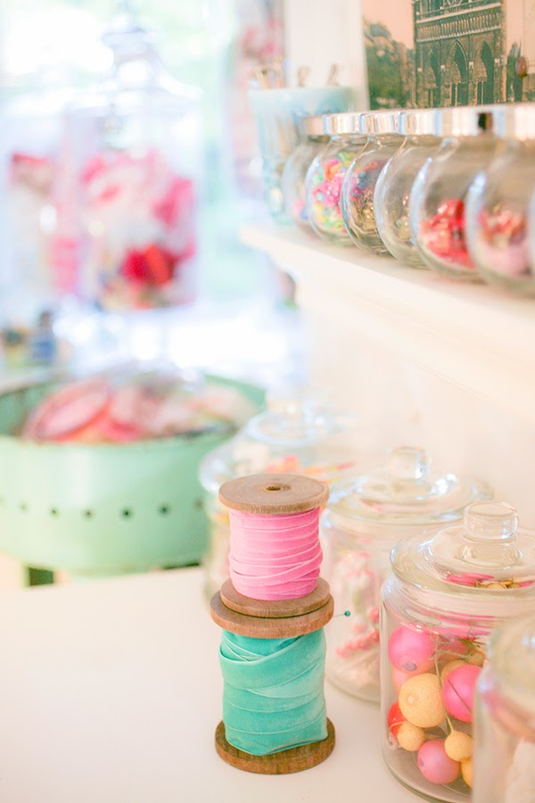 Using candy jars for storing mixed craft supplies - a whole post on creative craft room storage ideas - Fabric and ribbon storage that would be suitable for a craft room or sewing room. #craftroom #craftstorage #storage #craftsupplies