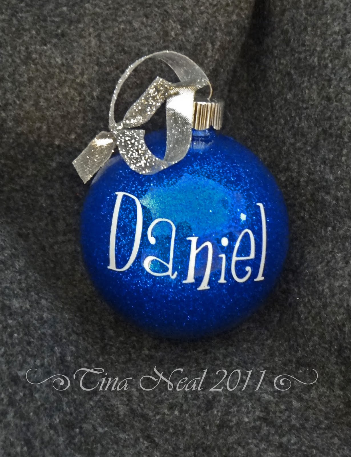 Ornaments with names on them - I Used Clear Glass Ornaments And Glittered The Inside Then I Personalized Them Cutting Names And Dates