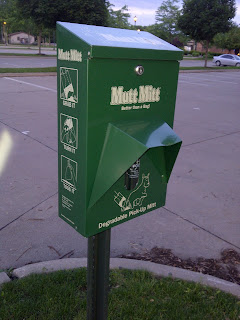 Green Mutt Mitt dispenser, looks like oversize parking meter