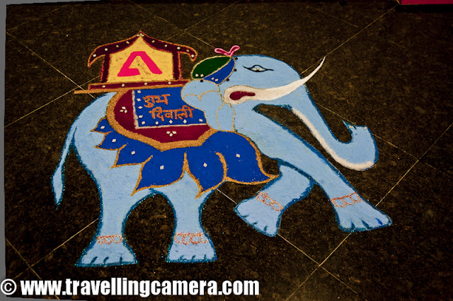Diwali Rangoli,Art at Adobe, Rangoli is a traditional decorative folk art of India. These are decorative designs made on floors of living rooms and courtyards during Hindu festivals and are meant as sacred welcoming areas for the Hindu deities. The ancient symbols have been passed on through the ages, from each generation to the one that followed, thus keeping both the art form and the tradition alive. Rangoli and similar practices are followed in different Indian states; in Tamil Nadu, one has Kolam, Madanae in Rajasthan, Chowkpurna in Northern India, Alpana in Bengal, Aripana in Bihar, and so on. The purpose of Rangoli is decoration and it is thought to bring good luck. Teams make rangolis every year before Diwali at Adobe. However, this time the patterns were incredibly intricate and imaginative.Om is the sacred symbol of Hinduism, Buddhism, and Jainism and can often be seen in religious arts. Rangoli is no exception.The traditional rending of a new bride in a Doli. In medieval and ancient India and for a long time even in modern India, after marriage, dolis bourne on the shoulders of 4-6 men were used to transport the new bride to her husband's home. Marigold flowers (गेन्दा) are inseparable from Hindu Prayers and religios decorations. Idols of Deities are often adorned with garlands of marigold flowers and red roses.This is a clever integration of a peacock in the face of Lord Ganesh. While the peacock is the greatly revered in Hindu Scriptures, Lord Ganesh is the deity who the Hindus rely upon to take care of new entreprises. Beautiful colors and image! The peacock is also the National Bird of India.A pattern with the peacock in the center and outlined with marigold and rose petals.A Peacock is often referred to as a bird with a hundred eyes owing to the eye-like patterns in its tail feathers. The Kalash (a brass pot) is a symbol of abundance in Hinduism. It is often worshipped during the yagyas along with the deities in Arya Samaj branch of Hinduism. Full ren
