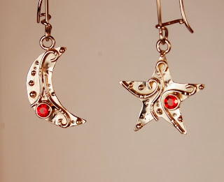 Moon shaped and star shaped pair of earrings with orange stones