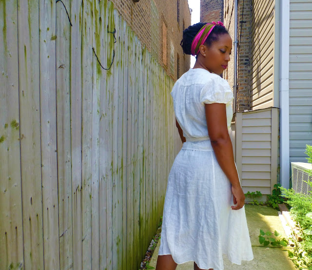 pinned up locs with a head scarf