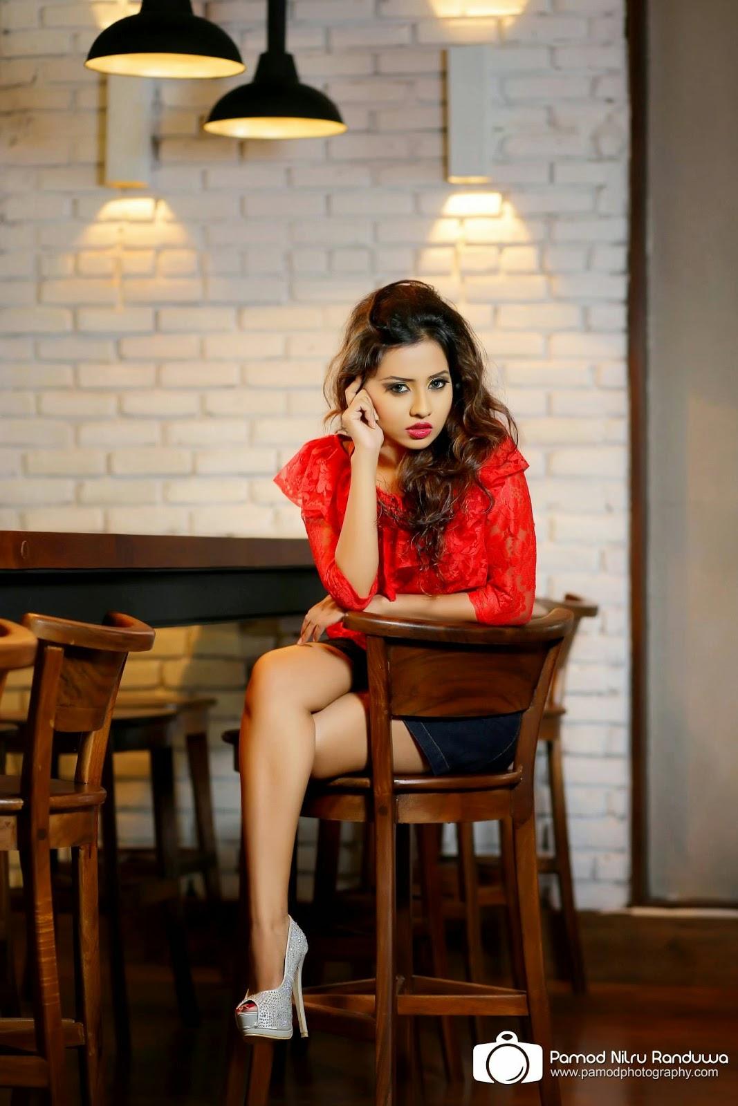Hiruni Bandara crossed legs